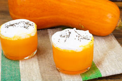 Pumpkin Juice Latte with Whipped Cream and Chia Seeds Royalty Free Stock Image