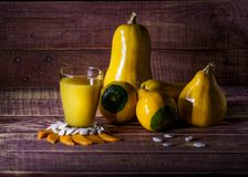 Pumpkin juice. Still life with pumpkin and pumpkin juice on a wooden table Stock Images