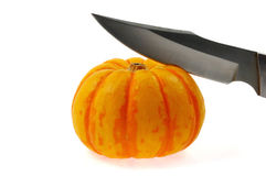 Pumpkin and knife. Pumpkin and a knife, a symbol of wealth-sharing Stock Photos