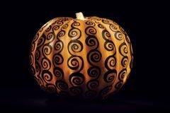 Pumpkin Lamp. A bright lit pumpkin on a black background Stock Photos