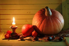 Pumpkin and lamp on wooden table Stock Images