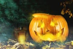 Pumpkin with lantern on dark background Royalty Free Stock Photos