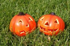 Pumpkin lantern on lawn Stock Images