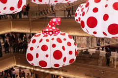 Pumpkin lanterns by Yayoi Kusama seen hanging from the ceiling of Tokyo`s Ginzasix shopping complex. Stock Photo