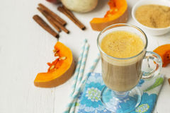 Pumpkin latte - coffee with pumpkin cream and hot drinks. Stock Photos