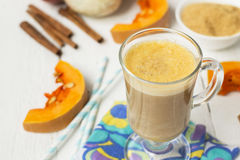 Pumpkin latte - coffee with pumpkin cream and hot drinks. Stock Photo