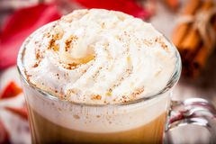 Pumpkin latte with whipped cream in a glass jar closeup Royalty Free Stock Images