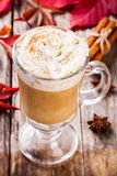Pumpkin latte with whipped cream in a glass jar Royalty Free Stock Images