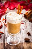 Pumpkin latte with whipped cream in a glass jar Stock Photo