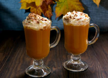 Pumpkin latte with whipped cream Stock Photos