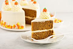 Pumpkin layered cake. With cream cheese frosting decorated with candy stock photography