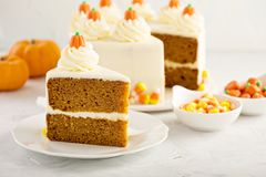 Pumpkin layered cake. With cream cheese frosting decorated with candy royalty free stock photo