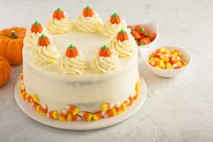 Pumpkin layered cake. With cream cheese frosting decorated with candy royalty free stock images