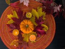 Pumpkin with leaves and candle. Pumpkin with candles and red, yellow maple leaves from above Stock Photography