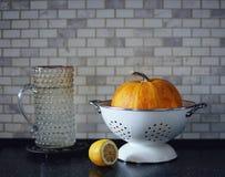 Pumpkin lemon food yellow color marble wall black table kitchen. Pumpkin lemon food yellow color light indoor kitchen white wall black table royalty free stock photo