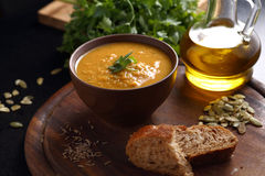 Pumpkin, lentil and carrot soup, bread and olive oil Royalty Free Stock Photos