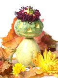 Pumpkin Man. A Halloween Pumpkin Man with flowers and autumn leaves Royalty Free Stock Image