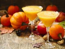 Pumpkin martini cocktail for Halloween parties. Pumpkin martini cocktail in glasses for Halloween parties Stock Image