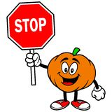 Pumpkin Mascot with a Stop Sign Stock Image