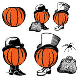 Pumpkin Men. Two pumpkins with vintage hats, shoes, a carpet bag and spider for Halloween Royalty Free Stock Photography