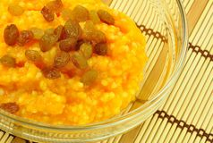 Pumpkin and Millet Gruel with Raisins. In Transparent Bowl on Bamboo Placemat Royalty Free Stock Photo