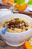 Pumpkin millet porridge with apple and raisins Stock Photography