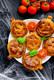 Pumpkin mini pizzas to Halloween party treats, creative idea for. The festive food top view Stock Image