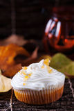 Pumpkin muffin with whipped cream Royalty Free Stock Image