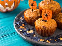 Pumpkin muffins for Halloween kids party Stock Images
