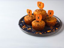 Pumpkin muffins for Halloween kids party on white Royalty Free Stock Images