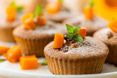 Pumpkin muffins. Sweet pumpkin muffins with walnuts and powdered sugar Stock Photo