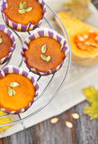 Pumpkin muffins on the wooden background Stock Photo