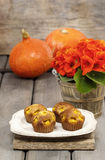 Pumpkin muffins on wooden table Stock Images