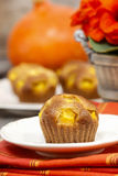 Pumpkin muffins on wooden table Stock Photos