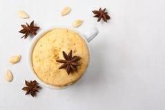 Pumpkin mug-cake on a white wooden table Royalty Free Stock Photo