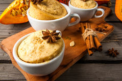 Pumpkin mug-cakes in rustic style Royalty Free Stock Images