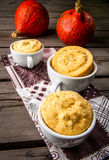 Pumpkin mug-cakes in rustic style Stock Photo