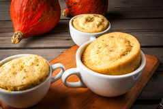 Pumpkin mug-cakes in rustic style Royalty Free Stock Photography