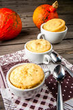 Pumpkin mug-cakes in rustic style Stock Photography