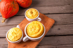 Pumpkin mug-cakes in rustic style Royalty Free Stock Image