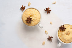 Pumpkin mug-cakes on a white wooden table Royalty Free Stock Image