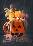 Pumpkin mug with sweets. For halloween party stock photo