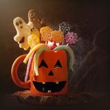 Pumpkin mug with sweets. For halloween party stock image