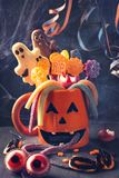 Pumpkin mug with sweets. For halloween party royalty free stock photography