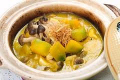 Pumpkin and mushroom stew in claypot Royalty Free Stock Photo