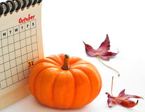 Pumpkin next to calendar Royalty Free Stock Image