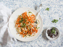 Pumpkin noodles spaghetti. Tasty vegetarian food. On a light background Stock Photo