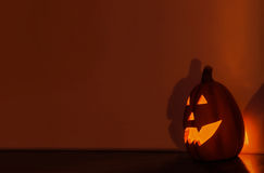 Pumpkin in the nothing. Pumpkin lantern lighting the wall Stock Images