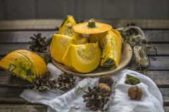 Pumpkin nuts autumn harvest dark old table royalty free stock images