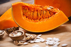 Pumpkin, nuts and seeds on a table Stock Photo